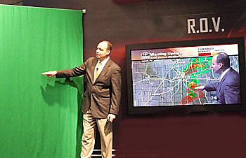 weathercaster using chroma key